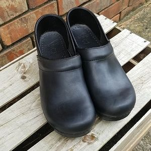 Dansko black leather clogs
